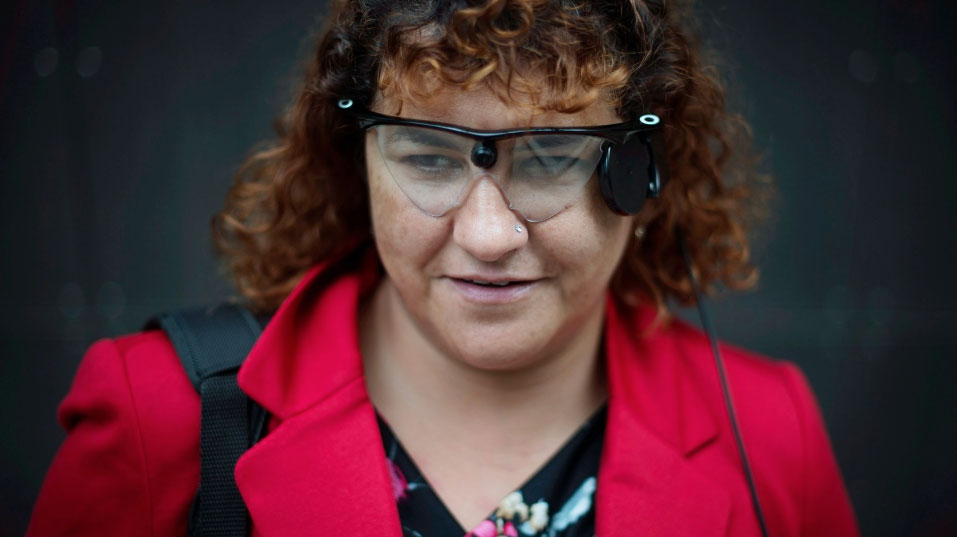 Orly Shamir, a credit analyst, wears the Argus Retinal Prosthesis System (Argus II) while posing in Toronto on Tuesday Oct 14, 2014