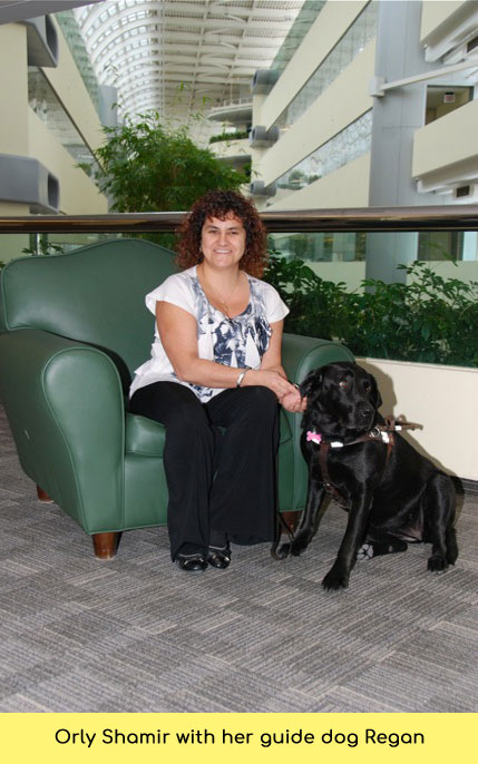 Orly with her guide dog Regan
